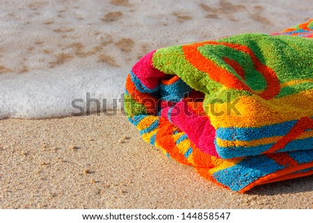 towel beach on the sandy beach with space for text - stock photo