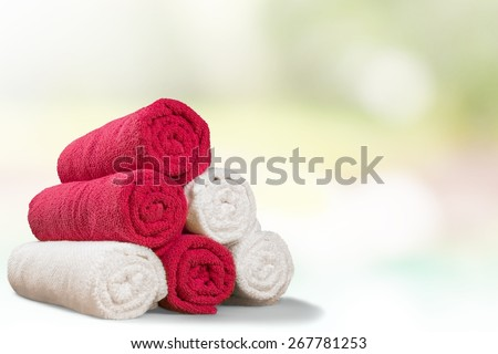 Towel. Five rolled multicoloured bath towels isolated on white - stock photo