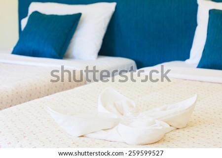 Towel flower on bed at Banana Garden Beach, Koh lanta, Krabi, Thailand. - stock photo