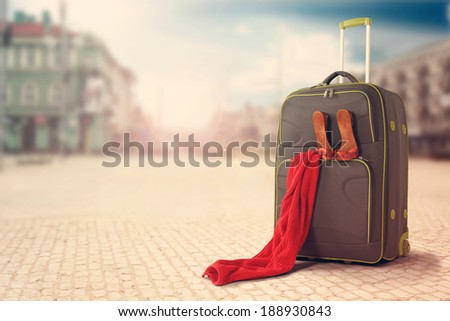 towel of red and big bag in the city  - stock photo