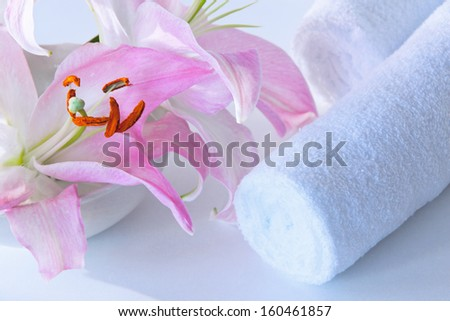 Towel with lily close up - stock photo
