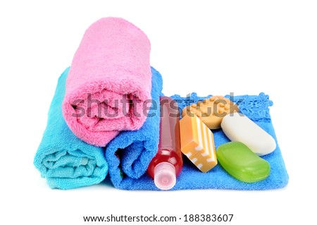 towels and soap isolated on white background - stock photo