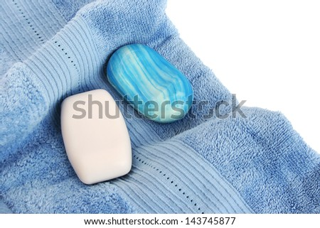 Towels and soaps on white background. - stock photo