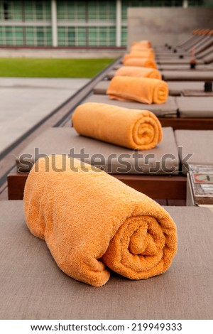 Towels near the swimming pool. - stock photo