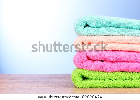 Towels on blue background - stock photo