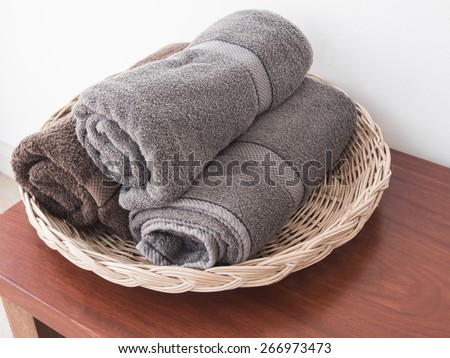 Towels roll on wooden table - stock photo