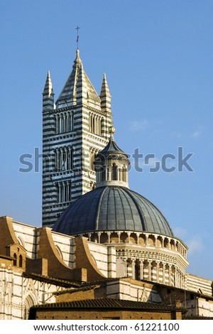 tower and dome of Siena cathedral typical romanesque architecture in Tuscany Italy - stock photo