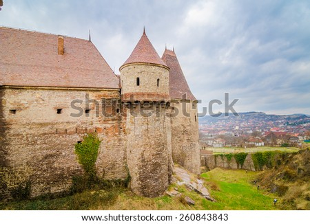 Tower and fortified wall at the Corvinilor Castle in Hunedoara Transylvania Region of Romania also called the Corvinesti, Huniazilor, Huniad Castle built during the 15 th century by Iancu de Hunedoara - stock photo