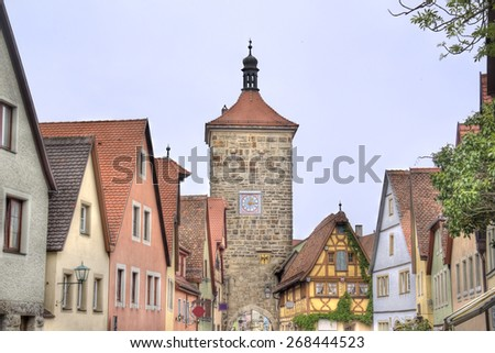 Tower and historical houses in the old city of Rothenburg ob der Tauber, Germany - stock photo