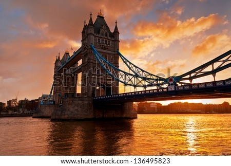 Tower Bridge against morning sunrise in London, England. This photo make HDR technic. - stock photo