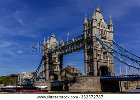 Tower Bridge (1886â??1894) - iconic symbol of London. It is a combined bascule and suspension bridge in London, over River Thames. Tower Bridge is close to Tower of London, from which it takes its name. - stock photo