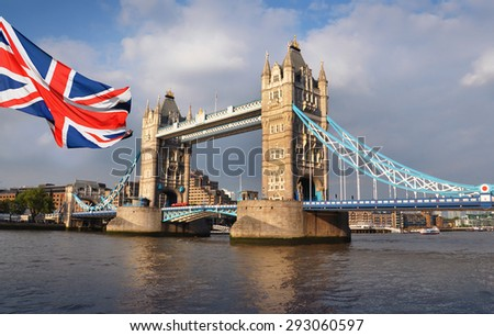 Tower Bridge in London and flag - stock photo