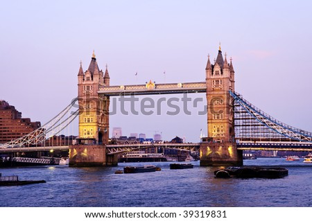 Tower bridge in London England at sunset over Thames river - stock photo