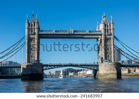 Tower Bridge in London on a beautiful sunny day seen from the river Thames - stock photo
