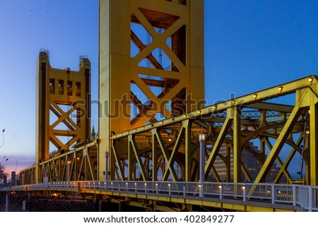 tower bridge in sacramento,ca at sunset - stock photo