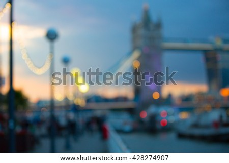 Tower bridge, London at twilight and first night's lights, blur background - stock photo