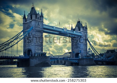 Tower Bridge London under ominous sky and vintage toned. - stock photo
