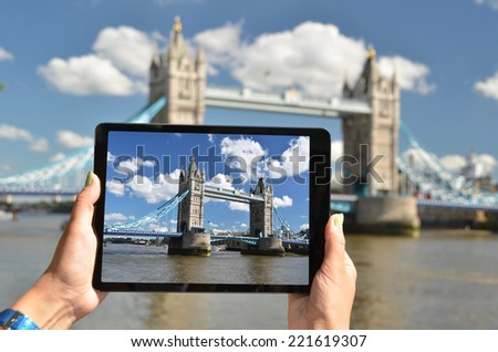Tower bridge on the screen of a tablet - stock photo