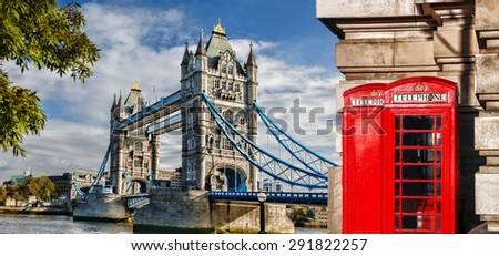 Tower Bridge with red phone booths in London, England, UK - stock photo