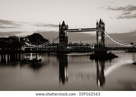 Tower Bridge with reflections in the morning over Thames River in London. - stock photo