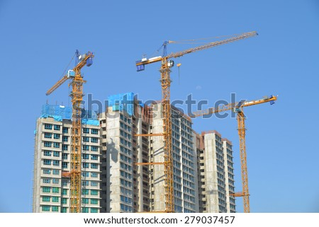 Tower Crane At A Work Site Against Blue Sky  - stock photo