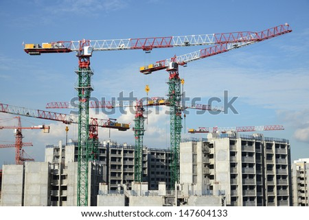 Tower Cranes At  Work Site - stock photo