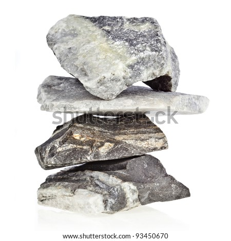 tower heap pile of natural marble stones isolated on white background - stock photo