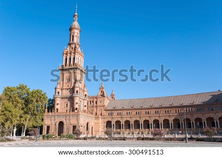 Tower of the Plaza de Espana in Seville in Spain.  It is a landmark example of the Renaissance Revival style in Spanish architecture. - stock photo