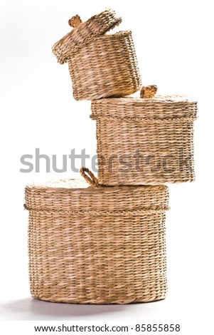 tower of three brown baskets isolated on white ground - stock photo