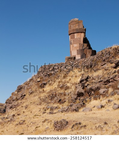 tower on the hill of Sillustani - pre-Incan burial tombs on the Lake Umayo near Puno, Peru - stock photo