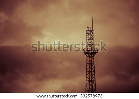 Tower silhouette on cloudy background vintage tone. - stock photo