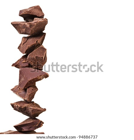 tower stack of chocolate pieces , border with copy space for your text - stock photo
