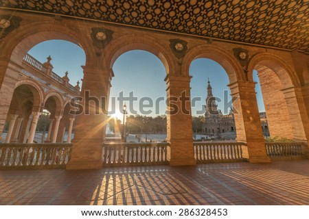Tower Through Archway of Plaza de Espana at dusk, Seville, Spain - stock photo