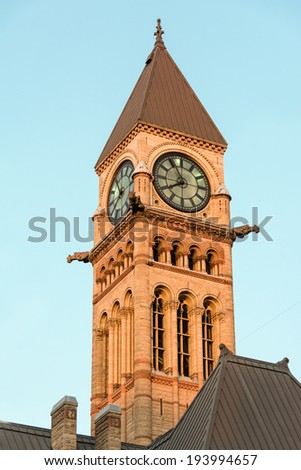 Tower with clock in the Old City Hall in downtown Toronto. Tourist landmark and a National Historic Site of Canada. It is one of the city's most prominent structures - stock photo