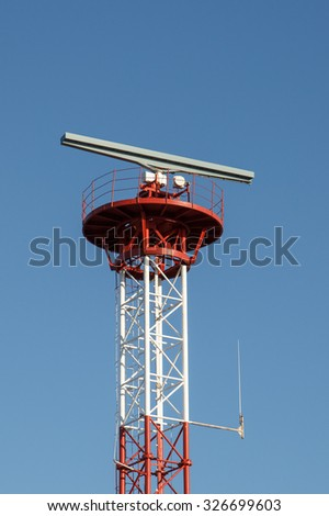 Tower with radar and antena against blue sky - stock photo