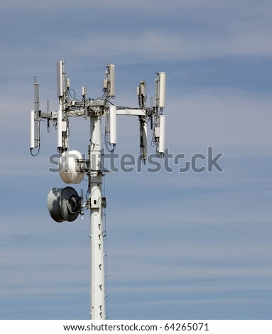 Tower with several different types of communications gear - stock photo