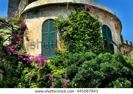 tower with window shutters and bougainvilleas in village Portovenere, Cinque Terre - stock photo