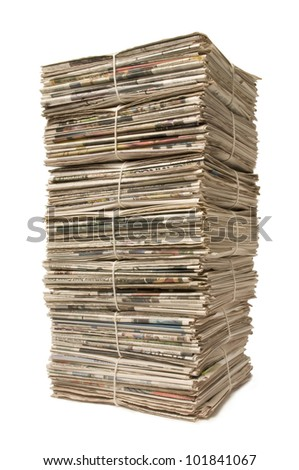 Towering stack of bound newspapers for recycling - stock photo