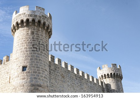Towers and battlements of the castle and fortress built in the XV century, located in the town of Sasamon Olmillos in the province of Burgos, Castile and Leon, Spain - stock photo