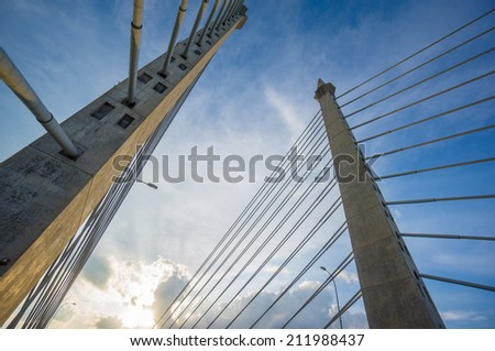 Towers of Bridge connecting George Town on Penang island and Seberang Prai on mainland of Malaysia through straits of Malacca - stock photo