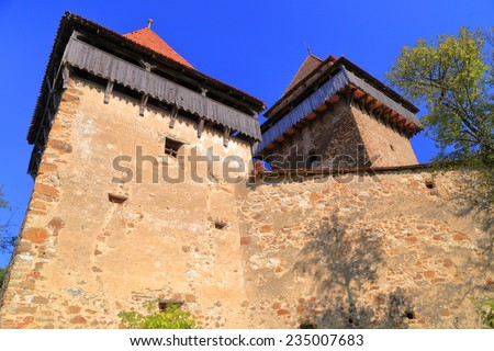 Towers of fortified church from UNESCO world heritage list in Viscri village, Transylvania, Romania - stock photo