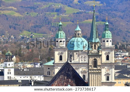 Towers of the Cathedral and Franciscan church above Salzburg old town, Austria - stock photo