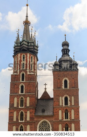 Towers of the Saint Mary church in Krakow. Old Town of Krakow is one of most famous old areas in Poland - stock photo