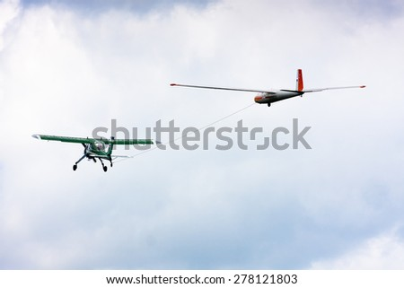 towing a glider by airplane - stock photo