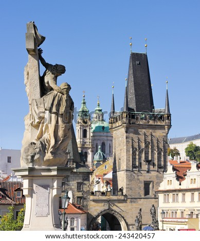 Town bridge tower and Saint Nicholas church, Prague, Czech Republic - stock photo