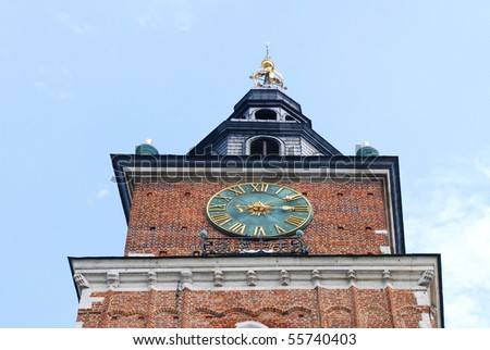 Town hall with clock in summer Krakow, Poland - stock photo