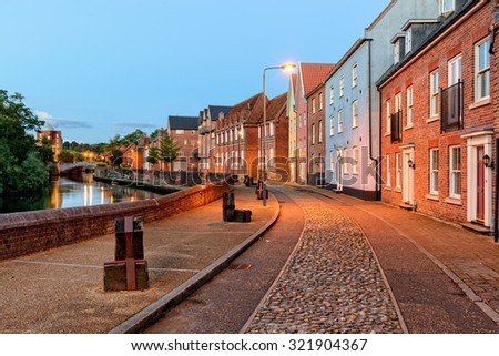 Town houses overlooking the river Yare in Norwich, Norfolk - stock photo