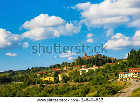 Town in the hills near Siena, Tuscany, Italy - stock photo