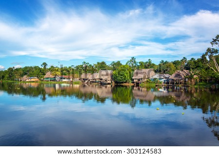 Town on the shore of the Yanayacu River in the Amazon rain forest near Iquitos, Peru - stock photo
