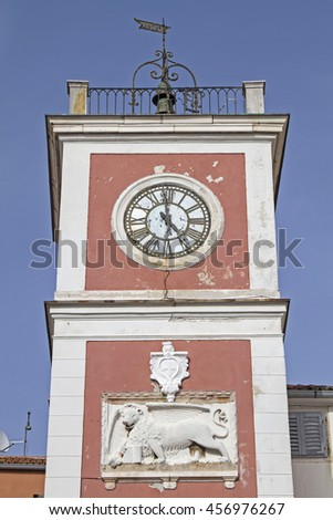 Town square of Rovinj with its famous red clock tower - stock photo